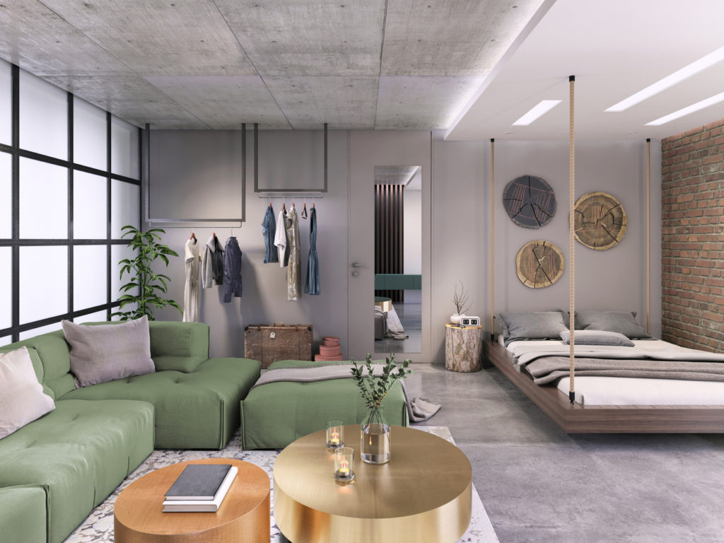 Modern interior, studio loft apartment with living room and bedroom in the same room. Clothes rack, bed hanging from the ceiling, large sofa, coffee table, brick wall. Lots of details, copy space background
